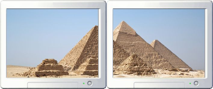 The Gizah pyramids stretched across a two-monitor setup, accounting for the gap between the monitors